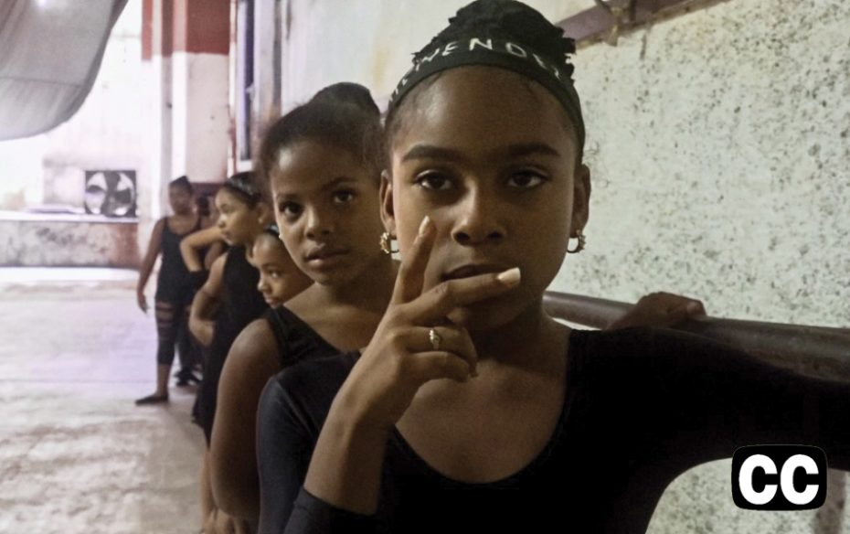 Watch trailer.  A group of dark-skinned girls in leotards lined up at the dance barre.