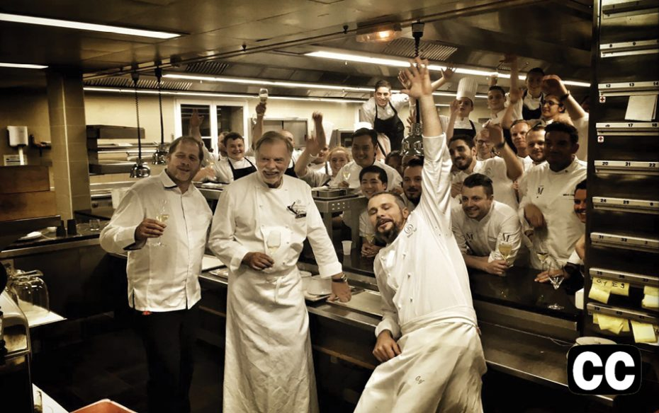 WATCH THE TRAILER. A group of jubilant chefs and workers in a restaurant kitche