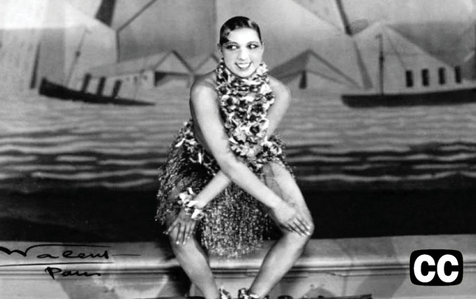 A black-and-white photo of performer Josephine Baker dancing on stage.