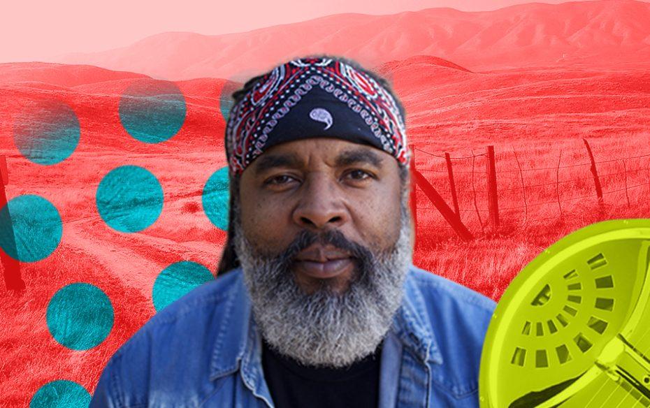 Alvin Yougblood Hart against a red landscape.
