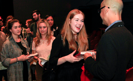 At Symphony Space, an author chats with patrons eager to have their books signed.