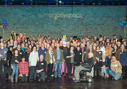 The staff and supporters of Symphony Space joyfully gathered on the stage of the Sharp Theatre.
