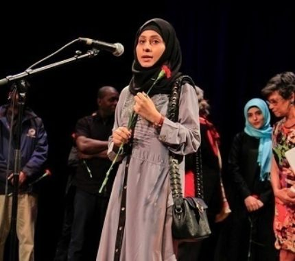 A young woman in hijab participates in Symphony Space's All Write! program.