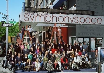 The staff and supporters of Symphony Space gather joyfully in front of the theater on West 95th Street.