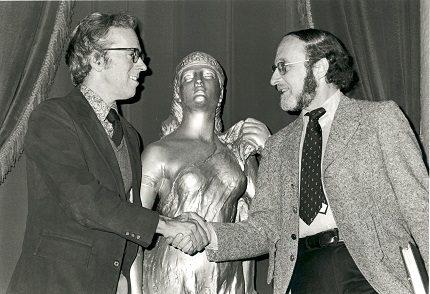 Allan Miller and Isaiah Sheffer shaking hands.